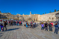 Western wall in jerusalem israel february tourists and prayers visiting and making their wishes at the wailing or kotel witch is Royalty Free Stock Photo