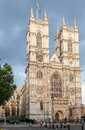 Westminster abbey london england the facade of with a british flag and its twin clock towers and adornments Royalty Free Stock Images
