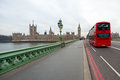 Westminster bridge views british parliament big ben london red double decker bus passes nearby Stock Images