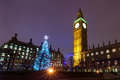 Westminster on a christmas night nighttime view of the tree outside the palace of in london england Royalty Free Stock Image