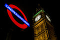 Westminster underground big ben view of the underneath the sign one night Royalty Free Stock Image