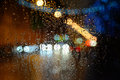 Wet the car window with the background of the night city Royalty Free Stock Photo