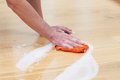 Wet cleaning rag a man the floor with a Royalty Free Stock Photography
