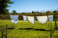 Wet clothes drying in the rope line Royalty Free Stock Photo