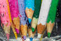 Wet color pencils behind the glass close up photo Royalty Free Stock Photo