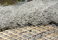 The wet concrete is poured on wire mesh steel reinforcement Royalty Free Stock Photo
