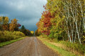 Wet country road autumn an rain moves onward and sunshine returns to a in central wisconsin Royalty Free Stock Photo