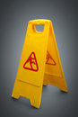 Wet floor sign on grey Royalty Free Stock Photo