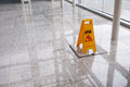 Wet floor sign on lobby Royalty Free Stock Images