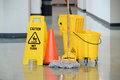 Wet Floor Sign With Mop Royalty Free Stock Photo