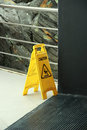 Wet floor yellow sign that alerts for Royalty Free Stock Photography