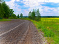 Wet gravel road Stock Photo