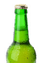 Wet green bottle of beer closeup Royalty Free Stock Images