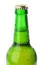 Wet green bottle of beer closeup