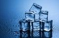 Wet Ice Cubes On Blue Background