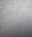 Wet metal background closeup of a piece of after rain Royalty Free Stock Photography