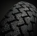 Wet motorcycle tire tread close up shot of classical in weather condition Stock Photos