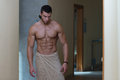 Wet Muscular Sexy Man Wrapped In Towel Royalty Free Stock Photo