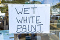 Wet paint sign in window a a shop Royalty Free Stock Image