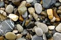 Wet pebbles upon  the shore Stock Photo