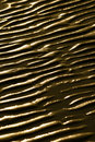 Wet ripple marks on sand Royalty Free Stock Photography