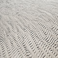 Wet rippled sand pattern texture on ocean beach a Stock Images