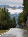 Wet road in the Swiss Alps Stock Photo