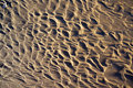 Wet sand on baltic beach natural textured back in ustka poland background Royalty Free Stock Photo