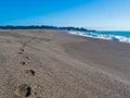 Wet sand foot prints California coast beach Royalty Free Stock Photo