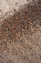 Wet sand and pebbles on baltic beach natural background near ustka poland Stock Photos