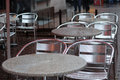 Wet tables and chairs of empty open-air cafe Stock Photography