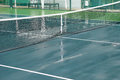 Wet tennis court Royalty Free Stock Photo