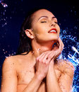 Wet woman face with water drop. Stock Photo