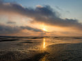 Wetlands sunset on north sea near rotterdam netherlands and ebb tide over the port of in south holland Stock Photos