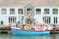 Weymouth quayside uk june restaurant building and fishing boat on the picturesque of harbour uk Stock Photography