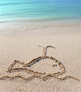 The whale - a picture on sand.Close up in a sunny day Royalty Free Stock Photo