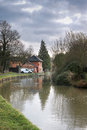 Wharf buildings at the end of the spur canal of the grand union canal at welford england Stock Photos