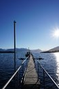 Wharf on a lake and snowcapped mountains Royalty Free Stock Images