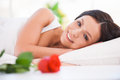 What a beautiful morning side view of young woman lying in bed with red rose Stock Photos