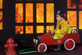 What a blaze preschool fireman sitting in his vintage firetruck exclaiming about the he sees through nighttime windows Royalty Free Stock Photos