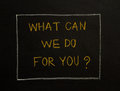 WHAT CAN WE DO FOR YOU? message on black background. Royalty Free Stock Photo