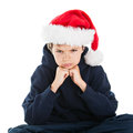 What a christmas teenage boy wearing santa hat is looking grumpy Royalty Free Stock Images