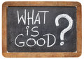 What is good question ethical concept white chalk handwriting on a vintage slate blackboard Royalty Free Stock Photos