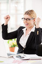 What a lucky day happy mature businesswoman sitting at her working place and gesturing Royalty Free Stock Photos