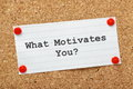 What motivates you the question typed onto a piece of lined paper pinned to a cork notice board Stock Photos