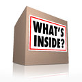 What s inside cardboard box delivery mystery carton question on a sticker on a to illustrate the mysterious contents of a parcel Stock Image