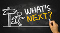 What s next concept hand drawing on blackboard Royalty Free Stock Photo