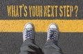 What`s your next step?, print with sneakers on asphalt road Royalty Free Stock Photo
