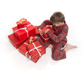 What santa left young boy in pajamas surrounded by gift boxes Royalty Free Stock Image