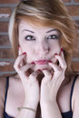 What should i do beautiful redhead posing with question Royalty Free Stock Image